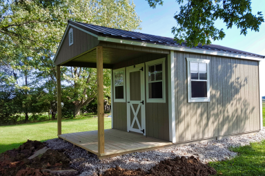backyard utility shed with porch