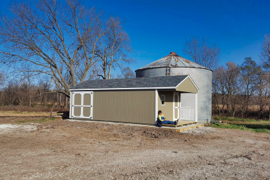 gable utility shed with porch