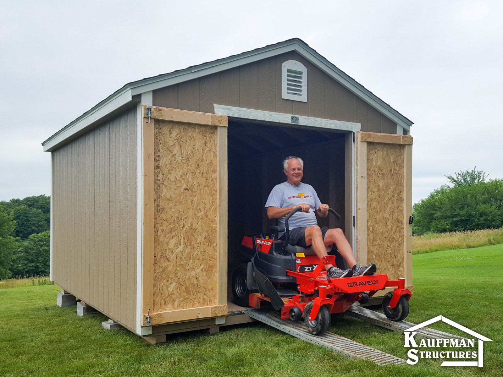 garden shed with a mower