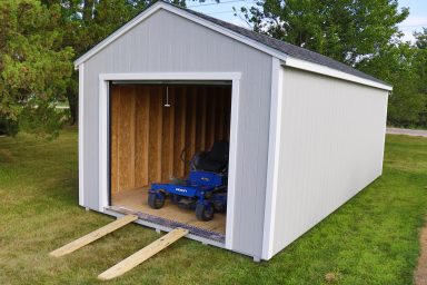 portable garage with a ramp