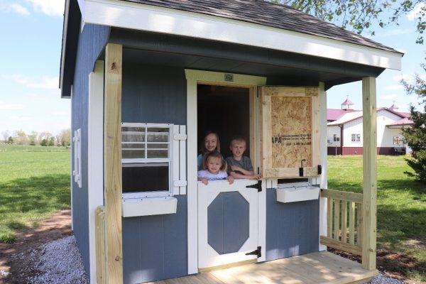 kids looking out of kids playhouse